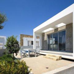 Отель Paradise Cove Luxurious Beach Villas Кипр, Пафос - отзывы, цены и фото номеров - забронировать отель Paradise Cove Luxurious Beach Villas онлайн балкон фото 2