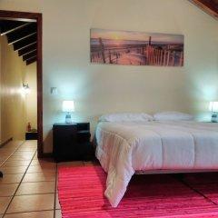 Отель A Casinha de Santa Cruz Санта-Крус комната для гостей фото 3