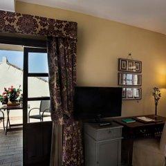 Alcazar De La Reina Hotel удобства в номере