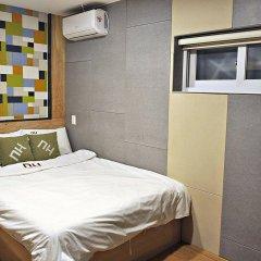 Отель D.H Sinchon Guesthouse Южная Корея, Сеул - отзывы, цены и фото номеров - забронировать отель D.H Sinchon Guesthouse онлайн комната для гостей фото 4