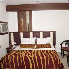 Отель Sarthak Palace Индия, Нью-Дели - отзывы, цены и фото номеров - забронировать отель Sarthak Palace онлайн комната для гостей фото 5