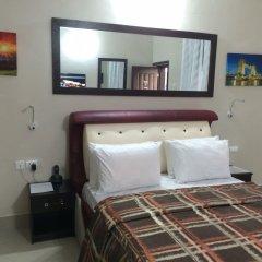 Отель Primal Hotel Нигерия, Лагос - отзывы, цены и фото номеров - забронировать отель Primal Hotel онлайн удобства в номере
