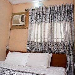 Отель Maxton Suites Magodo комната для гостей