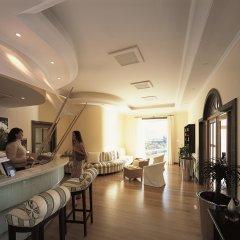 Отель Belmond Reid's Palace Португалия, Фуншал - отзывы, цены и фото номеров - забронировать отель Belmond Reid's Palace онлайн гостиничный бар
