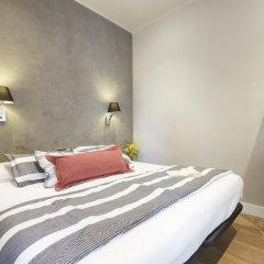 Отель AinB Eixample - Miró Барселона сейф в номере