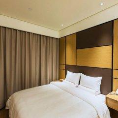 Отель JI Hotel Shanghai Hongqiao Transport Hub Linkong Zone Китай, Шанхай - отзывы, цены и фото номеров - забронировать отель JI Hotel Shanghai Hongqiao Transport Hub Linkong Zone онлайн комната для гостей фото 3