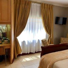 Отель J's Guesthouse удобства в номере