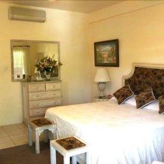 Отель Beachcombers Hotel Сент-Винсент и Гренадины, Остров Бекия - отзывы, цены и фото номеров - забронировать отель Beachcombers Hotel онлайн комната для гостей фото 5