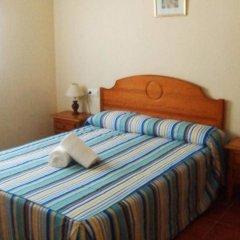Отель Apartamentos Las Parcelas Испания, Кониль-де-ла-Фронтера - отзывы, цены и фото номеров - забронировать отель Apartamentos Las Parcelas онлайн комната для гостей фото 2