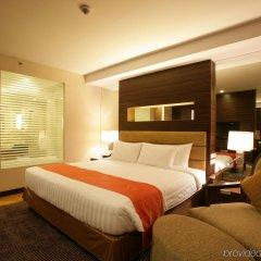 Отель Legacy Suites Sukhumvit by Compass Hospitality Таиланд, Бангкок - 2 отзыва об отеле, цены и фото номеров - забронировать отель Legacy Suites Sukhumvit by Compass Hospitality онлайн комната для гостей фото 3