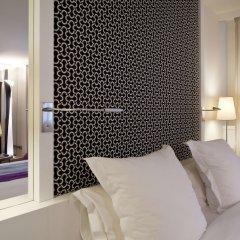 Отель La Villa Maillot - Arc De Triomphe Париж сейф в номере