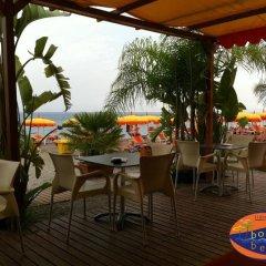 Отель Holiday Sun Lodge Appartamento Vacanze Джардини Наксос гостиничный бар