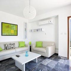 Отель Paradise Cove Luxurious Beach Villas Кипр, Пафос - отзывы, цены и фото номеров - забронировать отель Paradise Cove Luxurious Beach Villas онлайн комната для гостей фото 11