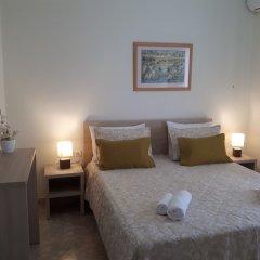 Апартаменты Sunset Relax Apartments комната для гостей