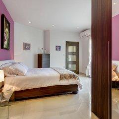 Отель Luxury 2 Bedroom Penthouse in St Julians Мальта, Сан Джулианс - отзывы, цены и фото номеров - забронировать отель Luxury 2 Bedroom Penthouse in St Julians онлайн комната для гостей фото 2