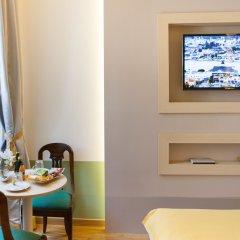 Отель Grand Master Suites в номере