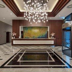 Hilton Garden Inn Izmir Bayrakli Турция, Измир - отзывы, цены и фото номеров - забронировать отель Hilton Garden Inn Izmir Bayrakli онлайн интерьер отеля