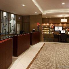 Отель Sheraton Poznan Hotel Польша, Познань - отзывы, цены и фото номеров - забронировать отель Sheraton Poznan Hotel онлайн интерьер отеля