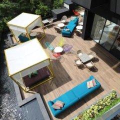 Отель Oakwood Studios Singapore Сингапур, Сингапур - отзывы, цены и фото номеров - забронировать отель Oakwood Studios Singapore онлайн балкон