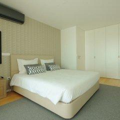 Апартаменты Deluxe Populo Beach Apartments комната для гостей фото 3