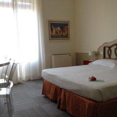 Отель Albergo Minerva Церковь Св. Маргариты Лигурийской комната для гостей