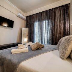 Отель Corona Deluxe Apt (Must) Греция, Салоники - отзывы, цены и фото номеров - забронировать отель Corona Deluxe Apt (Must) онлайн комната для гостей фото 2