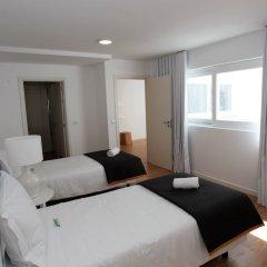 Отель Azorean Flats by Green Vacations Португалия, Понта-Делгада - отзывы, цены и фото номеров - забронировать отель Azorean Flats by Green Vacations онлайн комната для гостей фото 2