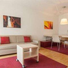 Апартаменты EMA house Serviced Apartments, Unterstrass Цюрих комната для гостей фото 5