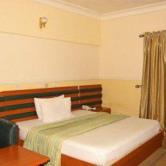 Отель Xcape Hotels and Suites Ltd Нигерия, Калабар - отзывы, цены и фото номеров - забронировать отель Xcape Hotels and Suites Ltd онлайн комната для гостей