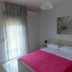 Апартаменты Nikos Apartments комната для гостей фото 4