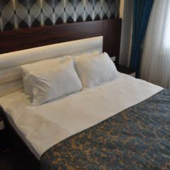 Отель Madi Otel Izmir комната для гостей