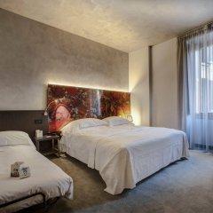 Отель Arli Business And Wellness Бергамо комната для гостей
