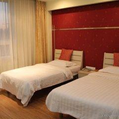 Отель Chinese Culture Holiday Hotel - Nanluoguxiang Китай, Пекин - отзывы, цены и фото номеров - забронировать отель Chinese Culture Holiday Hotel - Nanluoguxiang онлайн комната для гостей фото 4