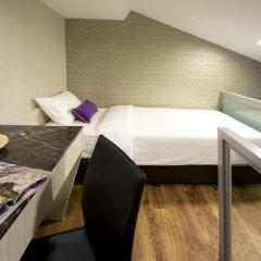 Отель V Bencoolen Сингапур в номере