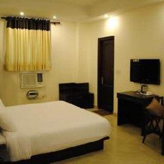 Отель Tulip Inn West Delhi комната для гостей фото 4