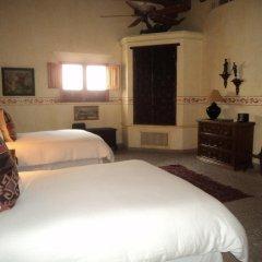 Отель Hacienda de Los Santos удобства в номере