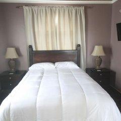 Отель Summer Breeze Vacation Home Ямайка, Монтего-Бей - отзывы, цены и фото номеров - забронировать отель Summer Breeze Vacation Home онлайн комната для гостей фото 2