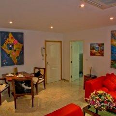 Апартаменты Mosaik Apartment Паттайя комната для гостей фото 5