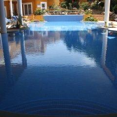 Отель Montinho De Ouro бассейн