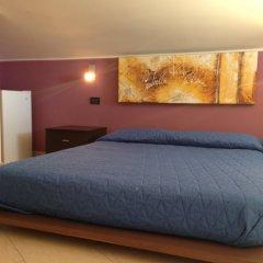 Отель Villa La Scogliera Фонтане-Бьянке комната для гостей