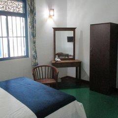 Отель Villa Whispering Shells удобства в номере