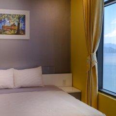 Апартаменты Sunrise Ocean View Apartment Нячанг комната для гостей