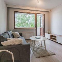 Апартаменты Local Nordic Apartments - Polar Bear Ювяскюля комната для гостей фото 5