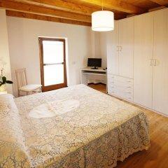 Отель Albergo Diffuso Tolmezzo Soc.Coop.Ar.L. Кьюзафорте комната для гостей фото 5