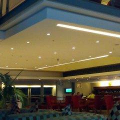 Отель Tinapa Lakeside Hotel Нигерия, Калабар - отзывы, цены и фото номеров - забронировать отель Tinapa Lakeside Hotel онлайн интерьер отеля фото 2
