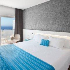 Suitopía Sol y Mar Suites Hotel комната для гостей