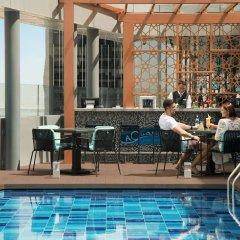Отель Pearl Rotana Capital Centre бассейн фото 2