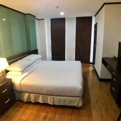 Отель Twin Peaks Sukhumvit Suites Бангкок комната для гостей фото 3