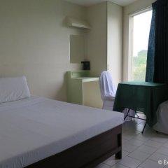 Отель Ponce Suites Gallery Hotel Филиппины, Давао - отзывы, цены и фото номеров - забронировать отель Ponce Suites Gallery Hotel онлайн комната для гостей фото 4