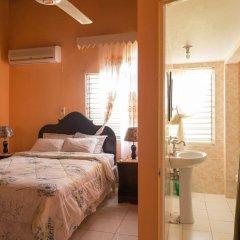 Отель Diamond Villas and Suites Ямайка, Монтего-Бей - отзывы, цены и фото номеров - забронировать отель Diamond Villas and Suites онлайн комната для гостей фото 2